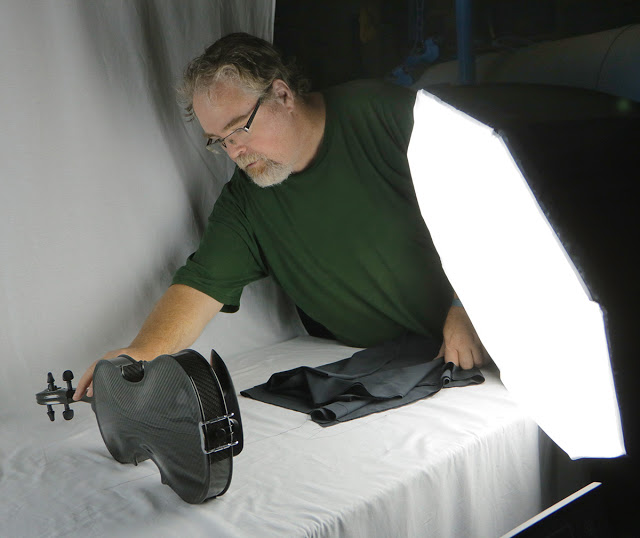 David Delouchery of Hawkeye Films sets up a shot for a publicity still of the Gayford Carbon Strad Violin