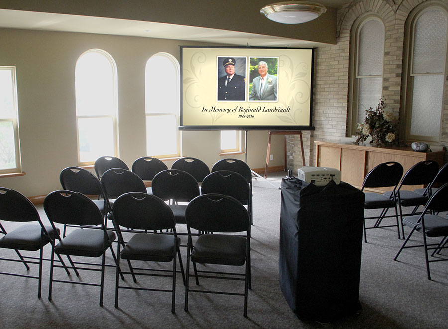 Video projection of live camera coverage for large funerals and overflow seating area